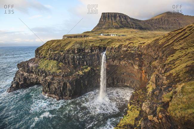 Faroe Islands - November 17, 2015. Waterfall in Gasadalur, which is a village on Vagar in the Faroe Islands.
