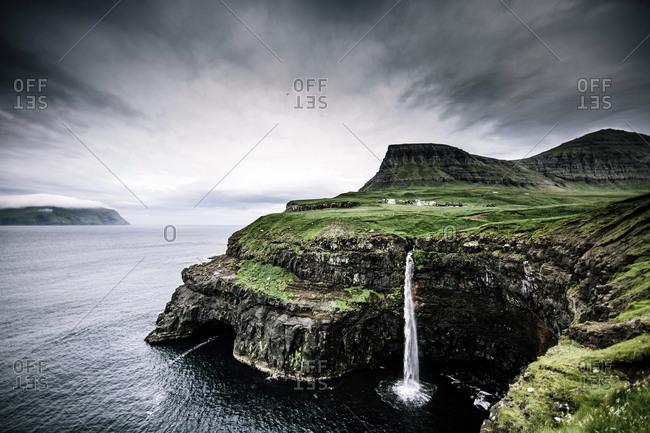 Gasadalur, Faroe Islands - July 23, 2014. Waterfall in Gasadalur, which is a village on Vagar in the Faroe Islands.