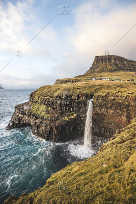 Faroe Islands - November 17, 2015. Waterfall in Gasadalur, which is a village on Vagar in the Faroe Islands.