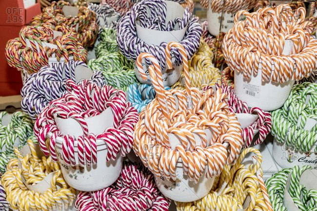 Milan, Italy - April 13, 2017: Candy canes arranged by color
