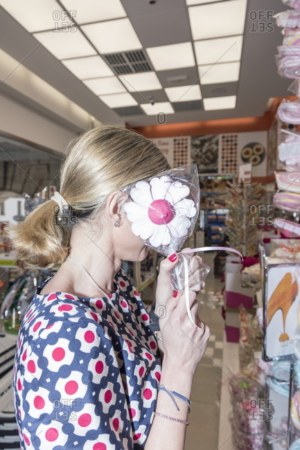 Milan, Italy - April 13, 2017: Woman covering face in candy store