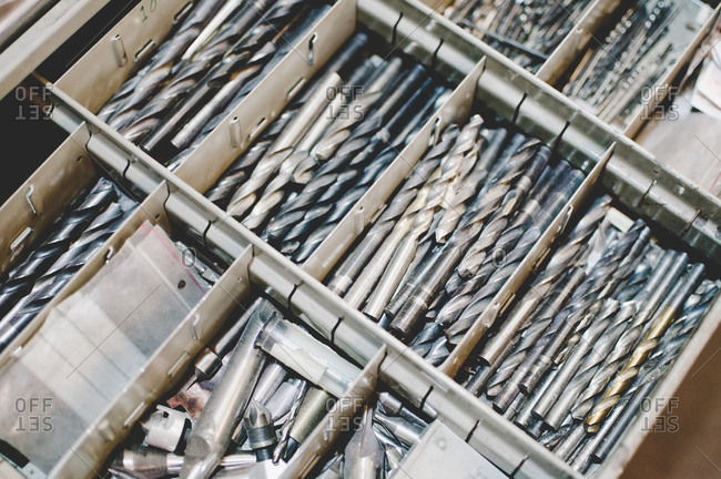 High angle view of drill bits in toolbox