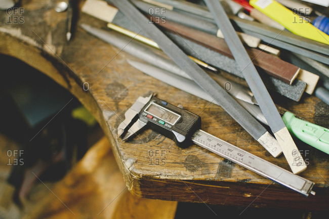 High angle view of digital caliper on workbench in jewelry workshop