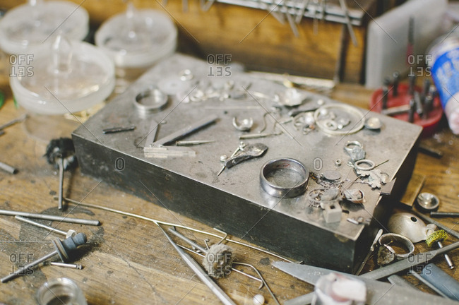 Jewelry making tools on workbench in workshop