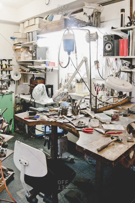Various work tools on workbench in jewelry workshop