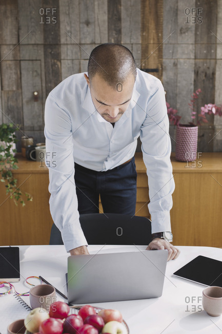 High angle view of businessman using laptop at desk in portable office truck