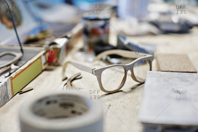 Eyewear frame on table at workshop