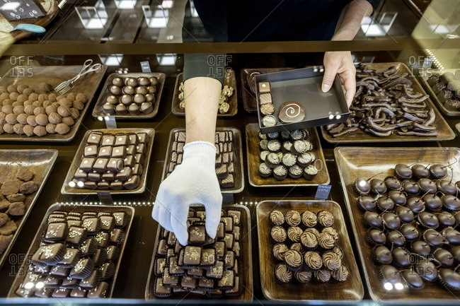 Hand boxing up artisan chocolates, Italy