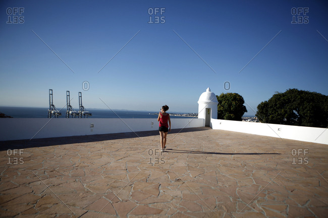 Woman on coastal terrace, Brazil