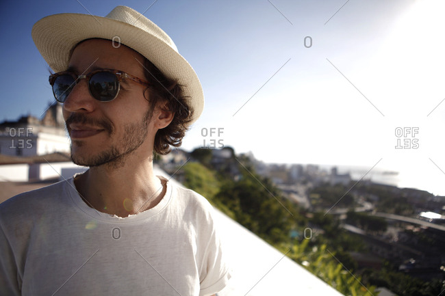 Man in hat by a coastal view, Brazil