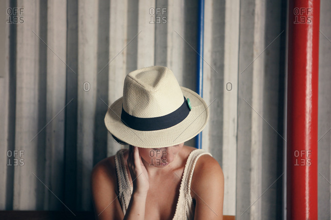 Woman in Panama hat looking down
