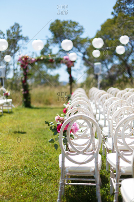 Rows of chairs set up for outdoor wedding