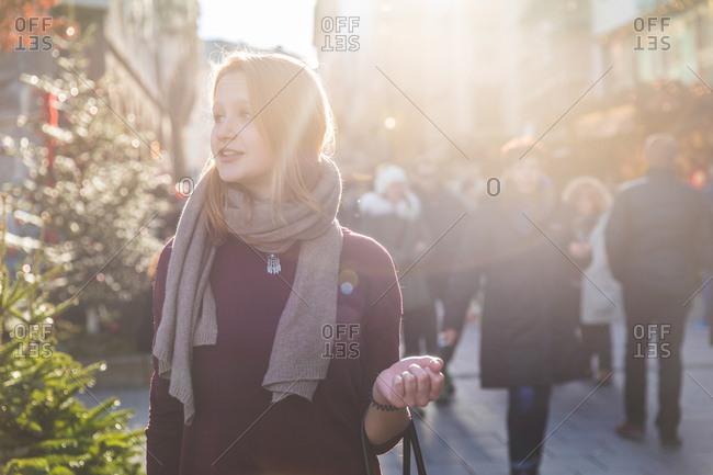 Young woman shopping at Christmas market
