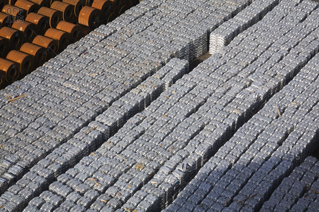 High angle view of aluminum ingots and coiled steel waiting for shipment at port