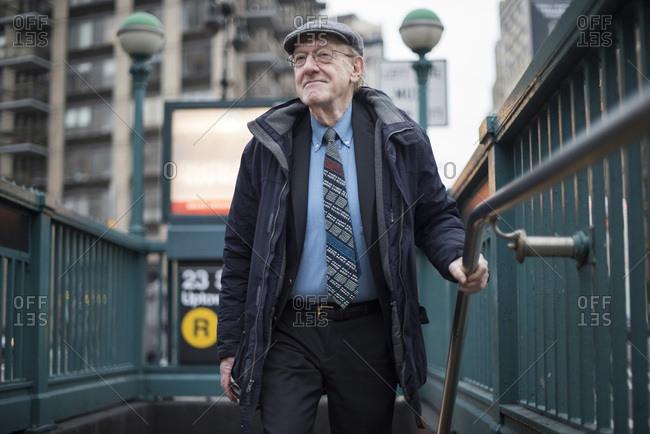 Man walking up subway stairway, Manhattan, New York, USA