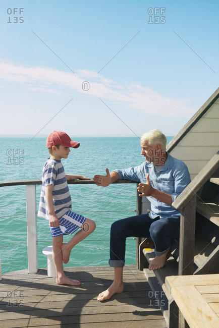 Grandfather and grandson on houseboat, Kraalbaai, South Africa