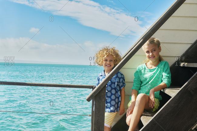 Boy and girl on houseboat stairs, Kraalbaai, South Africa