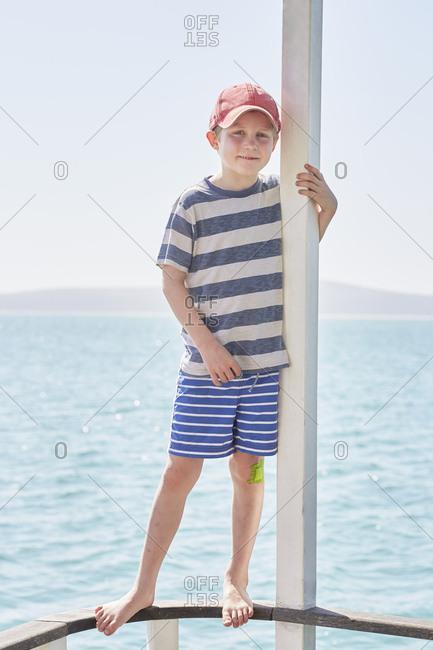 Boy on houseboat deck, Kraalbaai, South Africa