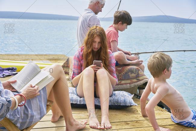 Family relaxing on houseboat sun deck, Kraalbaai, South Africa