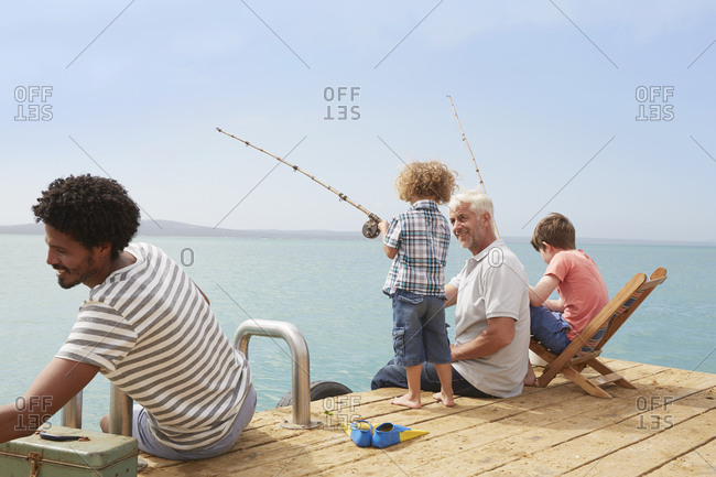Family fishing on houseboat deck, Kraalbaai, South Africa