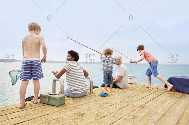Family fishing on houseboat deck, Kraalbaai, South Africa
