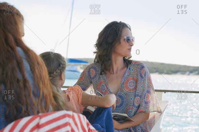 Woman on houseboat sun deck looking away, Kraalbaai, South Africa