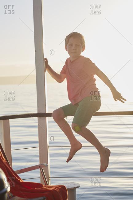 Portrait of boy on houseboat sun deck, Kraalbaai, South Africa