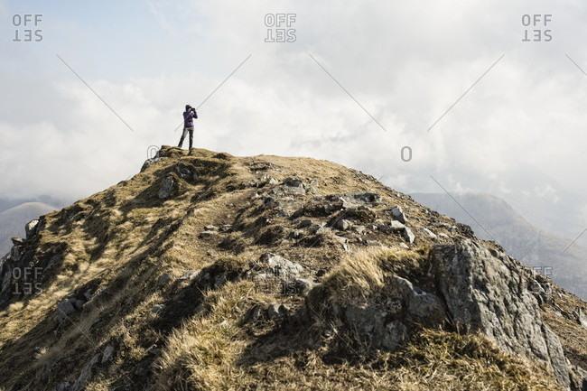 Woman on top of Marsco, Glen Sligachan, Isle of Skye, Scotland