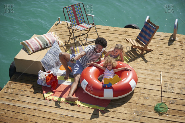 Family taking selfie on houseboat deck, Kraalbaai, South Africa