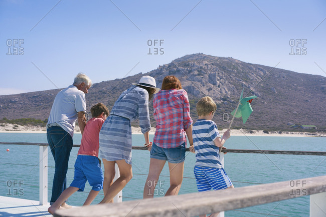 Family on houseboat looking away at view, Kraalbaai, South Africa