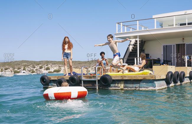 Family having fun on houseboat sun deck, Kraalbaai, South Africa