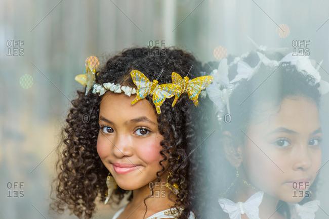 Portrait of two girls, wearing butterflies in hair