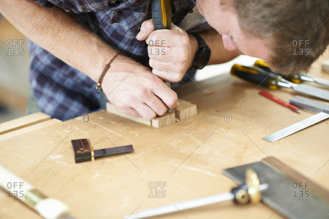 Man working in carpentry workshop, close-up