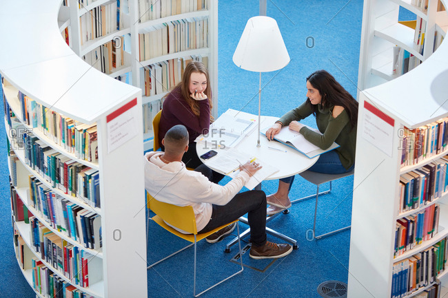 University students working in library