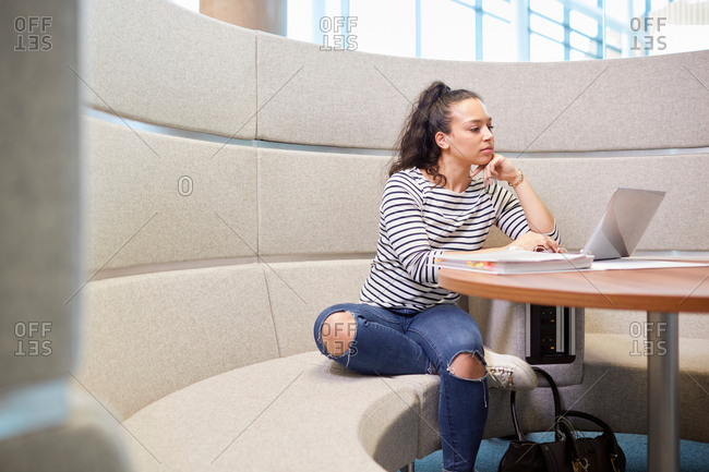 University student working in modern seating area