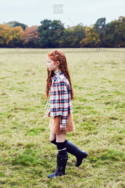 Young girl, walking through field