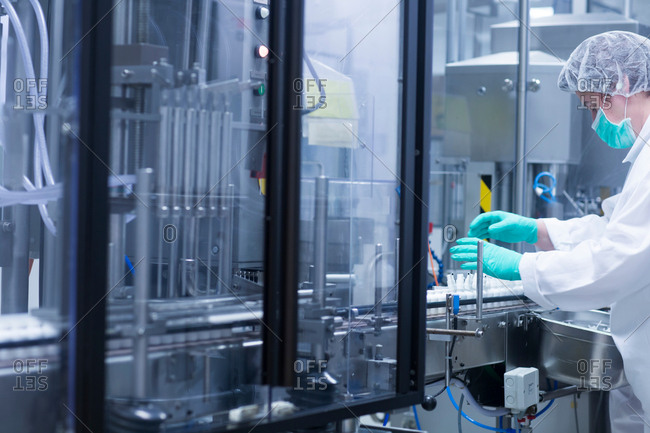 Worker packaging products in pharmaceutical plant