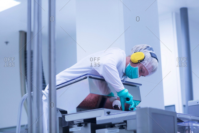 Worker operating machinery in pharmaceutical plant