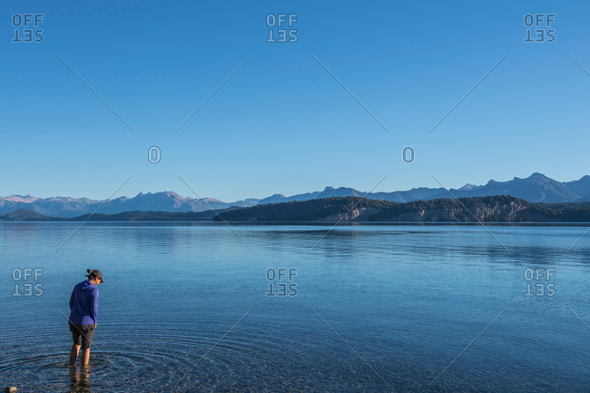 Woman trying the water at Nahuel Huapi Lake in Patagonia