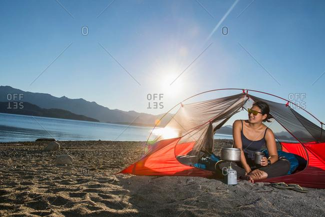 Woman camping at Nahuel Huapi Lake in Patagonia