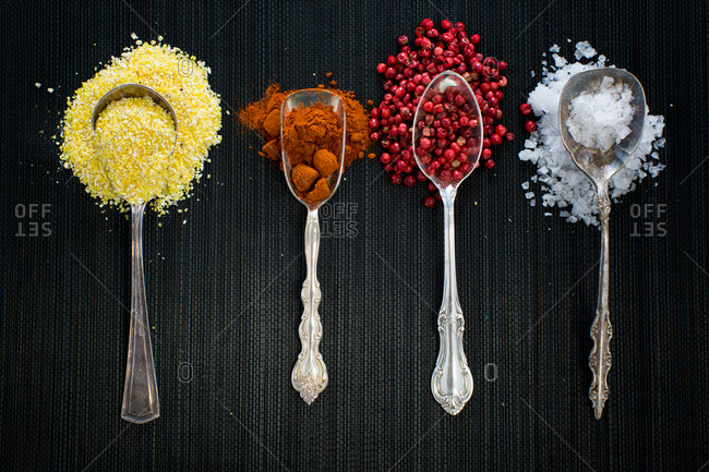 Antique spoons with different spices