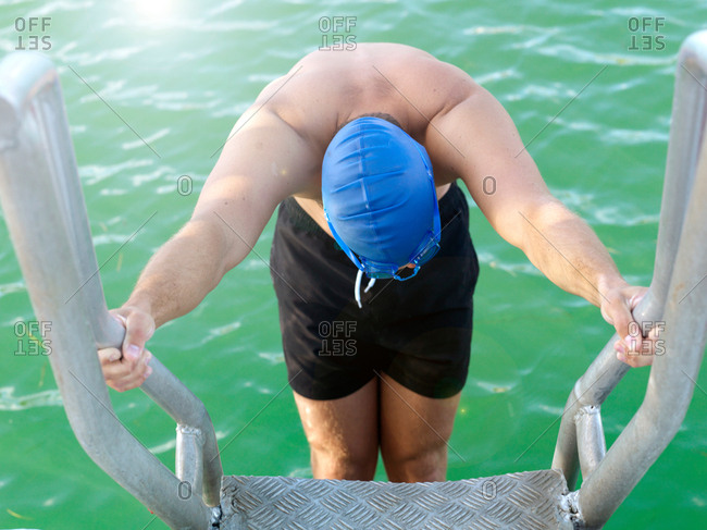 Swimmer on ladder into water, Eastern Beach, Geelong, Victoria, Australia