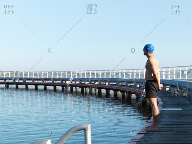 Swimmer contemplating on boardwalk, Eastern Beach, Geelong, Victoria, Australia