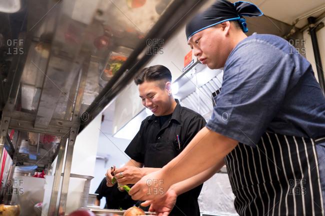 Chefs in kitchen preparing food