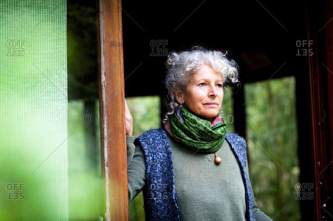 Portrait of woman in doorway looking away