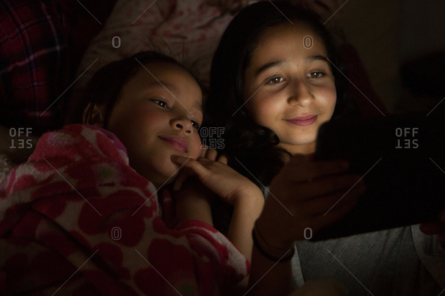 Girls slumber party using digital tablet