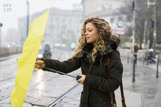 Woman with umbrella, Milan, Italy