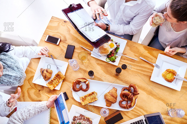 Overhead view of business team having working lunch in restaurant