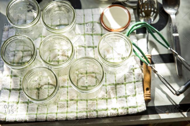 Overhead view of sterilised preserves jars on tea towel