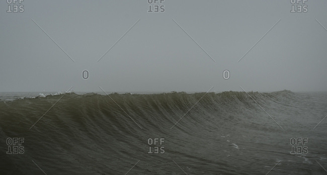 Seascape with fog and rising wave, Hoek van Holland, South Holland, Netherlands
